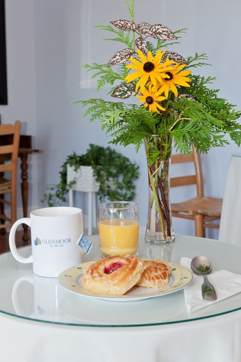 sunflowers on the table with continental breakfast