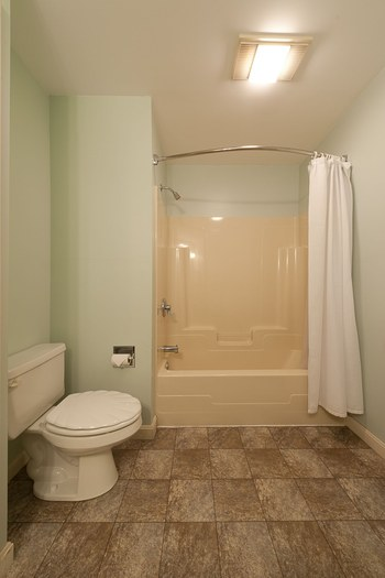 bathroom with a tile floor