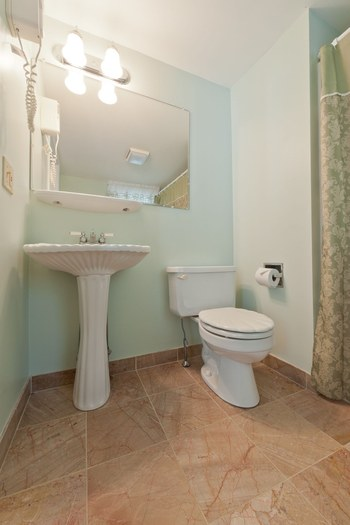 toilet and sink and tiled floor