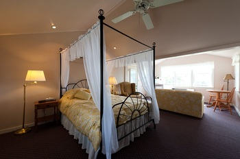 another canopy bed with a dark floor